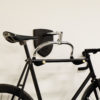 Black Bike Hanger on a wall with a black bicycle